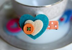 Baby Hair Clips Toddler Hair Clips Kids Hair Clips Blue Ivory Felt Heart Hair Clip HairBow. $3.00, via Etsy.