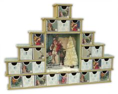 """<p>When these new Shadow Box Drawers were released by Kaisercraft, I was determined to make one up as an Advent Calendar. I love the little central section and decided I wanted to make a little wintry scene in it and wanted to make the whole calendar feel more wintry than Christmas <a href="""" http://www.merlyimpressions.co.uk/blog/project-portfolio/beyond-the-page/a-wintry-advent-calendar/ """"> …click to read more</a></p>"""