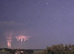 Sprites in Oklahoma. Sprites are electrical discharges that come out of the top of thunderclouds, opposite ordinary lightning bolts which plunge toward Earth. Sprites can tower as high as 90 km above ground.