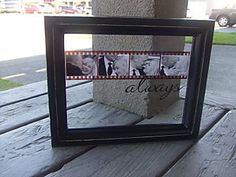 "A floating frame with small wedding photos covering up actual photos from a 35mm film negative.  Then with vinyl add ""always"""