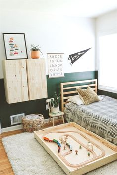 modern kid room with pull out train table boys room ideas, boy bedroom decor, boy bedroom design, boy bedroom furniture, boy room artwork ideas with dark green walls