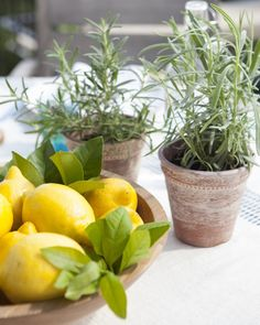 """""""Use a fresh centerpiece like this one to instantly brighten your table and add some subtle citrus fragrance to the space,"""" says Styles. """"Pile store-bought lemons high in your favorite shallow bowl, then tuck sprigs of greenery clipped from your yard into the arrangement."""""""