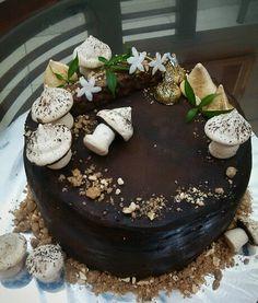 Layers of chocolate mocha sponge cake, caramel mousse, coffee hazelnut cremeux, caramel mousse, chocolate ganache