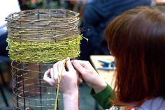 weaving flexible plant material onto mesh