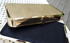 Gold and black clutch £40