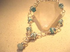Blue Orbit Wire Spiral Wrapped Blue Bracelet by TheChiMuse on Etsy, $23.00