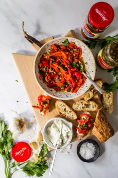 I'm elevating my Labor Day appetizer this year with #Mezzetta by creating a simple 6 ingredient appetizer. Using Mezzetta Roasted Bell Peppers and elevating with Mezzetta Capers, garlic, olive oil, parsley, salt and topping it on top of a crostini topped with a creamy chevre cheese. #ad #MezzettaMakesItBetta