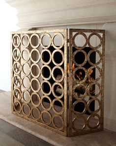 """Golden Circles"" Fireplace Screen at Horchow -- kitchen fireplace"