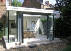Modern glass extension at the rear of a Victorian family house Glass Extension, Rear Extension, Extension Ideas, Industrial Office Design, Pleasant View, Old Cottage, London House, House Doors, House Extensions