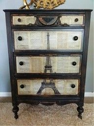 redo an old dresser with book pages! I am loving the Eiffel Tower graphic over the aged book pages here! This is a really  beautifully redone and very unique piece --Really want to try this technique :).... maybe with newspaper instead of book pages