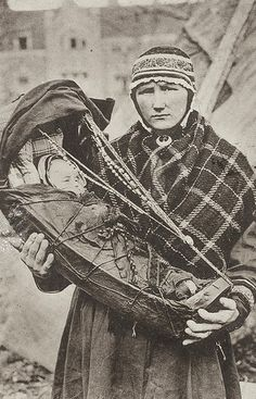 Sami woman with child in Komse, Finland.