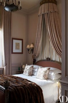 The guest room's gilded bed is 19th-century French | archdigest.com