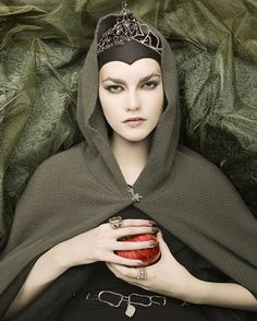 ...The Evil Queen brings Snow White the Poison Apple...