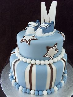 Baby shower cake / Blue tennis shoes on top. could be a Cowboys theme???