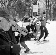 1955: Students at Plymouth State Teachers College, New Hampshire, square dance in their 'raquettes', or snow shoes. Getty Images