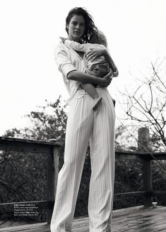 Babe on the hip - beautiful trousers. Killer combo. Shot by John Balsom for Harper's Bazaar.