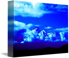 """""""Mystical Mount Shasta in Blue"""" by Sherrie Larch, Northern California  // This photograph of Mount Shasta was taken during late August and it was very warm but she still had a huge amount or snow on top living up to her Karuk name White Mountain. The clouds around her always do very unique and beautiful things, on this day it looked like they were... // Imagekind.com -- Buy stunning fine art prints, framed prints and canvas prints directly from independent working artists and photographers."""