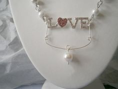 Love Necklace by TheBeadedBrain on Etsy, $12.75