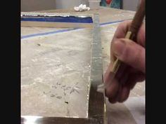 Burnishing gold or silver leaf with an agate stone during water gilding makes the leaf shine while compressing it into the surface, making it more durable. Gold Leaf, Seattle, How To Apply, Nyc, Traditional, Glass, Water, Youtube, Gripe Water