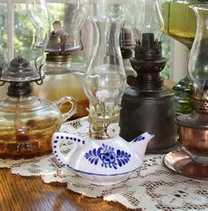 Brass, glass, copper, silver, blue and white oil lamps all available for wedding reception decor or lighting