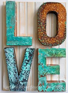 Paper mache letters transformed with Modern Masters Metal Effects by Artistic Home Studio & Boutique.
