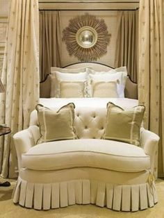 Kidney shaped, tufted and boxed-pleated settee with lovely lined and interlined bed curtains.  Restrained pattern and color make this bedroom restful despite incredible details. Phoebe Howard