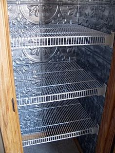 Pressed tin panels used inside a pantry to tizzy it up.