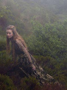 Margaery in Baratheon blacks and golds exploring the Kingswood, Harper's Bazaar Uk