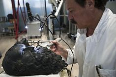 The Riace bronzes The palace of Council of the Calabria region, which houses the permanent conservation laboratory of the Bronzes of Riace. In the photo, the restorer of the Bronze Statues, Nuccio Dr. Schepis, during a restoration.