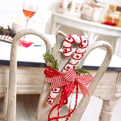 Surprising Spaces  Use ribbon to tie decorations in unexpected places, such as on the backs of chairs, on doorknobs, around vases, or on candlesticks.