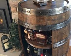 Whiskey barrel table | Etsy #barreltable,#reclaimedwoodcoffeetable,#winebarreltable,#whiskeybarreltable,#barrelendtable,#whiskeybarrelcoffeetable,#coffeetable,#barrelfurniture, #winebarrel,#winebarreltable, #whiskeybarreltable,#reclaimedwood Used Whiskey Barrels, Jack Daniels Whiskey Barrel, Bourbon Barrel, Barrel Bar, Barrel Sink, Drinks Cabinet, Liquor Cabinet, Table Baril