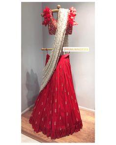 Beautiful red color designer lehenga and blouse with ivory dupatta. Lehenga and blouse with hand embroidery zardosi work. Blouse with bell sleeves. Brook collection of Mrunalini Rao Design . 25 April Customised This Garment log on to www. Wedding Gowns With Sleeves, Blue Wedding Dresses, Wedding Wear, Trendy Wedding, Party Dresses, Indian Dresses, Indian Outfits, Indian Clothes, Lehnga Blouse