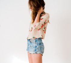 Distressed floral sweater