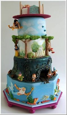 WOW! WHAT A CAKE! From Bottom to TOP: The Little Mermaid, Snow White, Pinocchio (?), Aladdin (?) and Sleeping Beauty on top! https://fbcdn-sphotos-h-a.akamaihd.net/hphotos-ak-ash3/q71/s720x720/150952_498202950269128_498370999_n.jpg