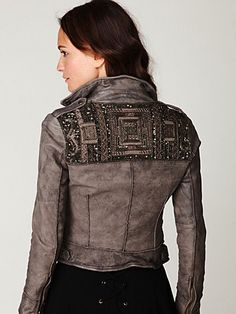 """Embellished Leather Jacket   Gorgeous distressed leather motorcycle jacket with bead and embroidery detailing in back. Three front zipper pockets. Buckle detailing at each side of waist. Snap button plackets at top of each shoulder. Fully lined.  *By Muubaa *Leather  *Professional Leather Cleaning Only  *Import  Measurements for Size UK 10 (equivalent to Size US 6):  Length: 21""""  Bust: 32""""   Waist: 30""""   Bottom Opening: 31""""  Shoulder Width: 15""""  Sleeve Length (from shoulder seam): 23 ½"""""""