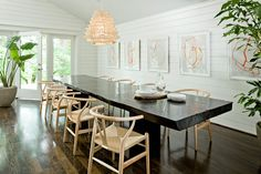 identical to dining room, wood planks for architecture, chairs match pendant, flooring is the same, solid wood table