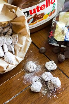 Nutella Puppy Chow - nutella in place of peanut butter, Ghirardelli chocolate, powdered sugar = magic.Picture