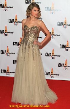 taylor swift and her amazing gold dresses....