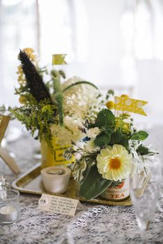 eclectic centerpieces // photo by Love Me Do Photography // http://ruffledblog.com/handmade-new-jersey-wedding