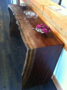Waterfall Walnut Side Board Note: when you have a beautiful piece of furniture like this, don't clutter it up with tacky, under scaled accessories.
