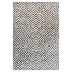 Hand-tufted wool rug with concentric diamond motif.  Product: RugConstruction Material: 100% WoolColor: Ivory and blueFeatures: Hand-tuftedNote: Please be aware that actual colors may vary from those shown on your screen. Accent rugs may also not show the entire pattern that the corresponding area rugs have.Cleaning and Care: Regular vacuuming and spot cleaning recommended