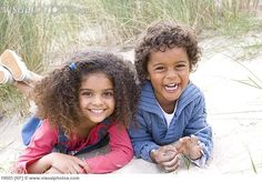 mixed kids | Portrait of two children lying on beach [19503] > Stock Photos ...