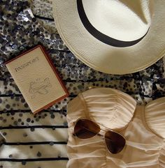 sunhat, passport, sunnies and a gorgeous cream swimsuit = perf summer day out