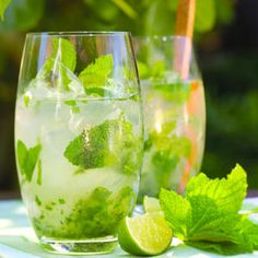 Mojito    In an 8- to 10-ounce glass, combine 20 rinsed fresh mint leaves (each about 1½ in. long) and 2 teaspoons superfine sugar.    With a wooden spoon, pound mint leaves with sugar to coarsely crush.    Add 4 to 5 tablespoons light rum, 3 tablespoons fresh lime juice; mix well.    Fill glass with ice cubes and 4 to 6 tablespoons chilled soda water.    Garnish with a sprig of fresh mint.