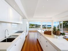 When you have a room with a view, all you need is a white kitchen! This amazing kitchen design is brought to you by Stritt Design & Construction. See more in our designer spotlight Newport Beach House, Best Kitchen Designs, Facade House, Coastal Homes, Kitchen Reno, Luxury Living, Old Houses, Cool Kitchens, All You Need Is