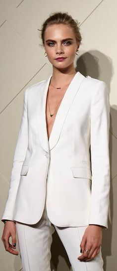 A simple white suit with no shirt underneath is the new craze on the red carpet this Sept/Oct. Its better to have your hair up and pulled back then down if you want to show off your features like cara does with her boyish frame