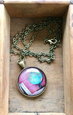 A favorite from my #etsy shop: Globe and Books World Travel Necklace Wanderlust  #booksandtravel #oneofakind