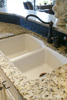 Our Kitchen/spray painted plastic/metal tin tiles for backsplash