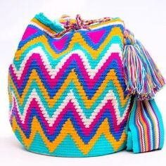 Cabo Wayuu Mochila bags are intricate in their designs, can take approximately 18 days to weave. Hand Woven Strap using woven one thread. Handmade in South America by the indigenous Wayuu people. Mochila Crochet, Tapestry Crochet Patterns, Denim Handbags, Tapestry Bag, Boho Bags, Crochet Purses, Womens Purses, Knitted Bags, Purses And Bags