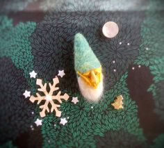 Check out this item in my Etsy shop https://www.etsy.com/uk/listing/554779510/needle-felted-brooch-christmas-elf